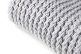 Knitted scarf texture over white with space for text — Stock Photo