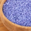 Sea salt enriched with lavender oil in wooden bowl close up — Stock Photo
