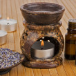 Aromatherapy lamp with oils and dried lavender — Stock Photo
