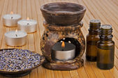 Aromatherapy lamp with oils and dried lavender — Photo