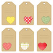 Set of gift tags with stitched hearts — Stock Vector #38599189
