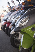 Row of scooters on the street — Stock Photo