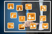 Businessman pointing human resource icon for business concept — Stock fotografie