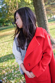 Woman with coat — Stock Photo