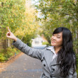 Portrait of woman pointing at something — Stock Photo