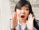 Portrait of woman looking surprised — Stock Photo