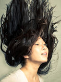 Woman flicking her hair — Stock Photo