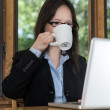 Woman with laptop and coffee — Stock Photo