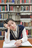Student with open textbook deep in thought — Stock Photo