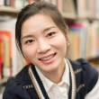 Portrait of girl smiling in library — Stock Photo