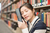 Girl resting head on old book — Fotografia Stock