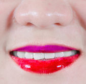 Woman lips with makeup smiling — Stock Photo