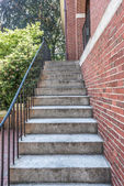Cement stairs next to wall — Stock Photo