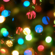 Holiday background with blurred lights — Stock Photo