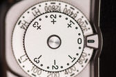 Exposure compensation dial on camera — Stock Photo