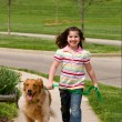 Young Girl Walking Dog — Stock Photo