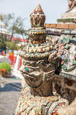 Close-up of demon guardian statue at Wat Arun temple in Bangkok, Thailand — Stock Photo