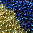 Christmas golden and blue beads — Stock Photo #32636843