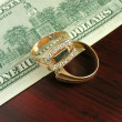 Stock Photo: Money and gold jewelry