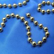 Christmas golden beads — Stock Photo #32637417