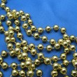 Christmas golden beads — Stock Photo