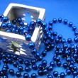 Silver candlestick and blue beads — Stock Photo #32637961