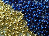 Christmas golden and blue beads — Stock Photo
