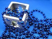 Silver candlestick and blue beads — Stock Photo