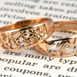 Stock Photo: Open page and rings