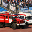 Stock Photo: Stadium. The fire machine and the automobile of the first help