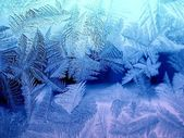 Icy pattern on glass — Stock Photo