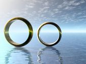Wedding rings in ocean. — Foto de Stock
