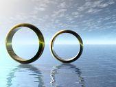обручальные кольца в океане. — Стоковое фото