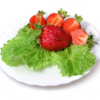 Stock Photo: Strawberries and green lettuce