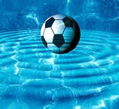 Football in water — Stock Photo