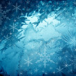 Blue snowflakes background — Stock Photo