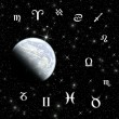 Twelve symbols of the zodiac over planet — Stockfoto