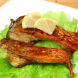 Stock Photo: Roasted fresh bream on plate