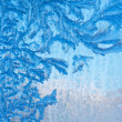Frosty natural pattern at a winter window glass — Stock Photo #35817909