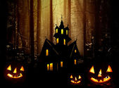 Halloween. Night. Castle and pumpkins. — Stock Photo