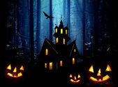 Halloween. Night. Castle and pumpkins. — Stock Photo