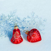 Christmas decorations on a snow — Стоковое фото