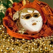 Venetian mask and golden beads — Stock Photo