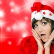 Charming young woman in santa cap — Stock Photo #36177957