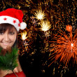 Young woman on firework background — Stok fotoğraf