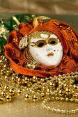 Venetian mask and golden beads — Zdjęcie stockowe