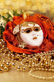 Enetian mask and golden beads — Stock Photo