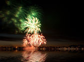 Firework in night city — Stock Photo