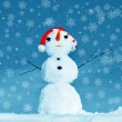 Snowman on snowflakes background — Stock Photo