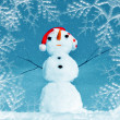 Snow man in santa cap — Stock Photo